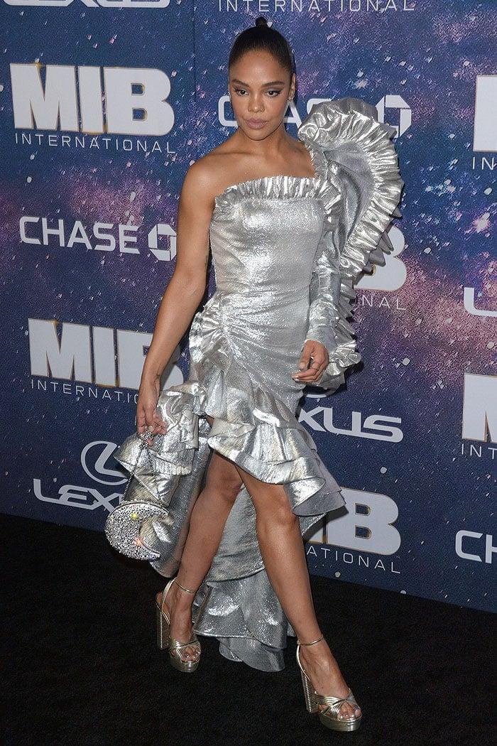 Tessa Thompson wearing a custom Rodarte silver space dress, Aquazzura 'Sundance' platforms, and a silver crescent moon purse