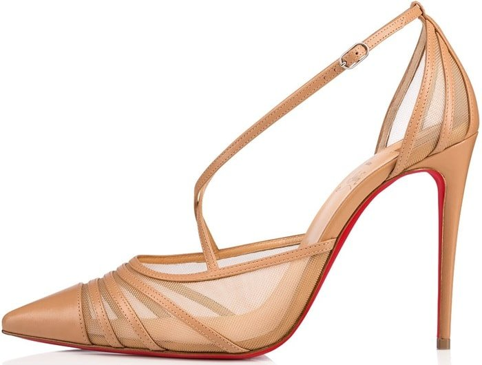 Set on a 100mm heel, a thin strap, projecting from the vamp, fits around the ankle