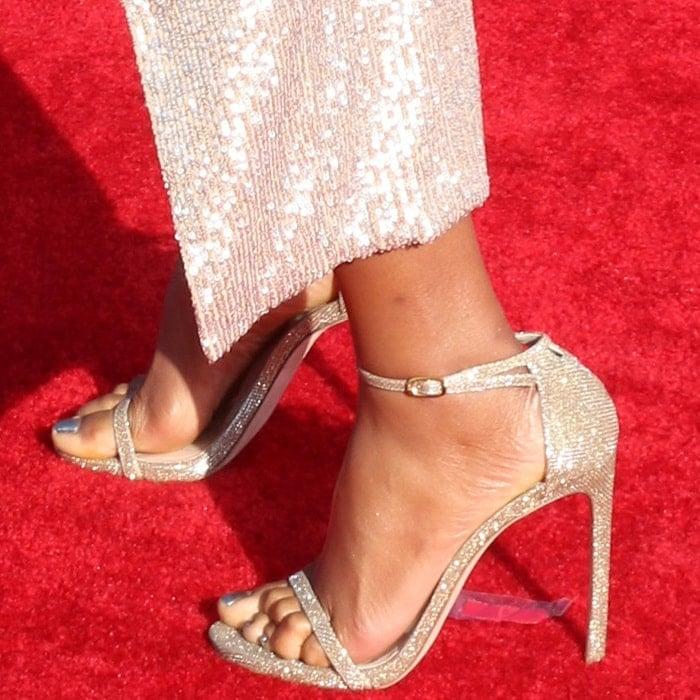 Tiffany Haddish's hot feet in Stuart Weitzman shoes