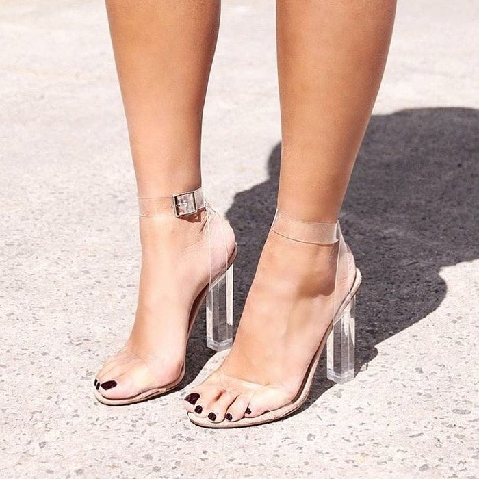 A transparent heel and straps add plenty of modern flair to a lofty, cleanly styled Kiki sandal