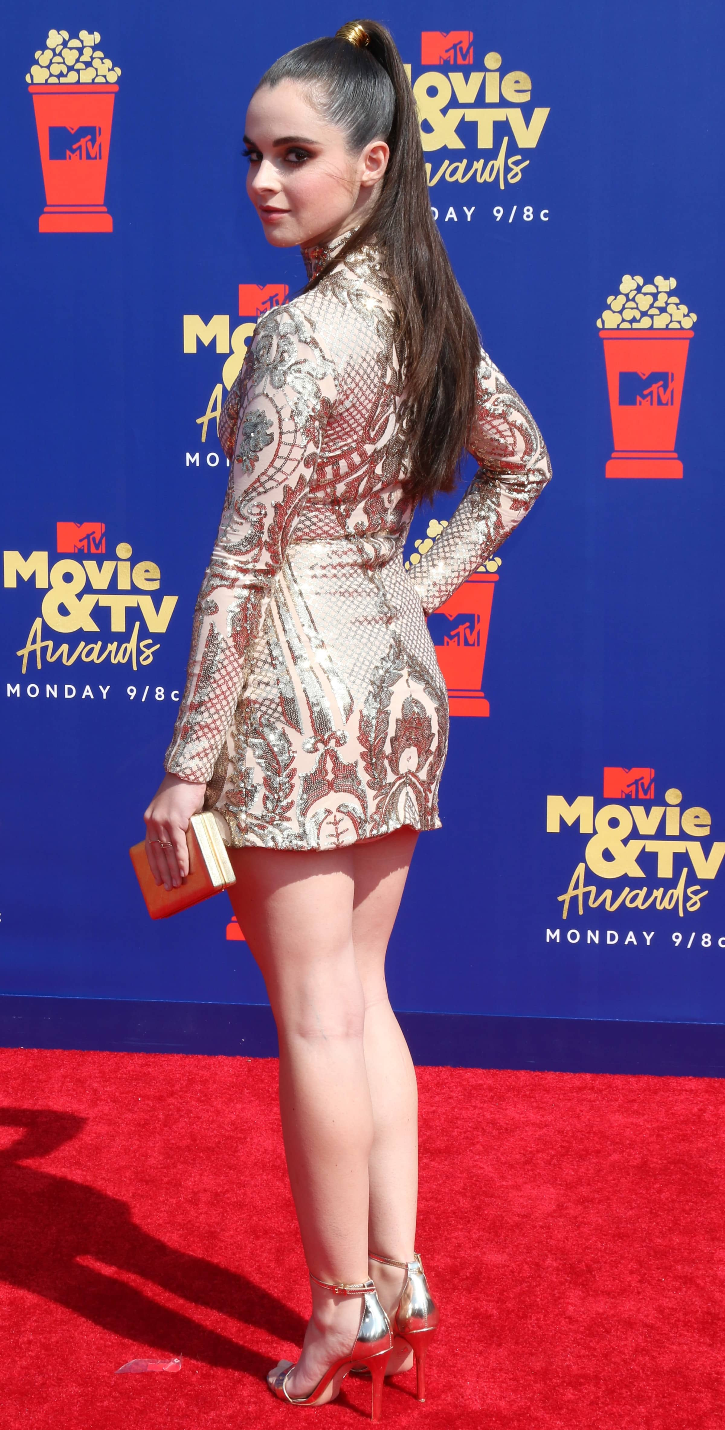 Vanessa Marano flaunted her legs in a gold sequined mini dress by Kimberly Parker