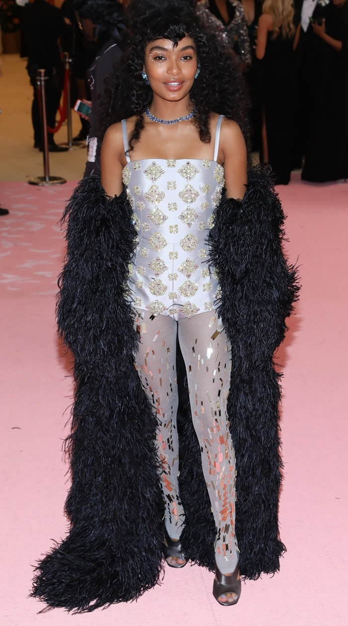 Yara Shahidi with extremely high hair on the pink carpet at the 2019 Met Gala