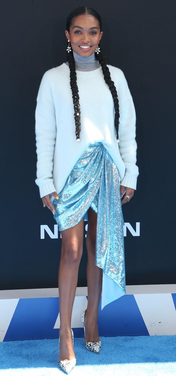 Yara Shahidi highlighted her long pins in an asymmetrical sarong skirt