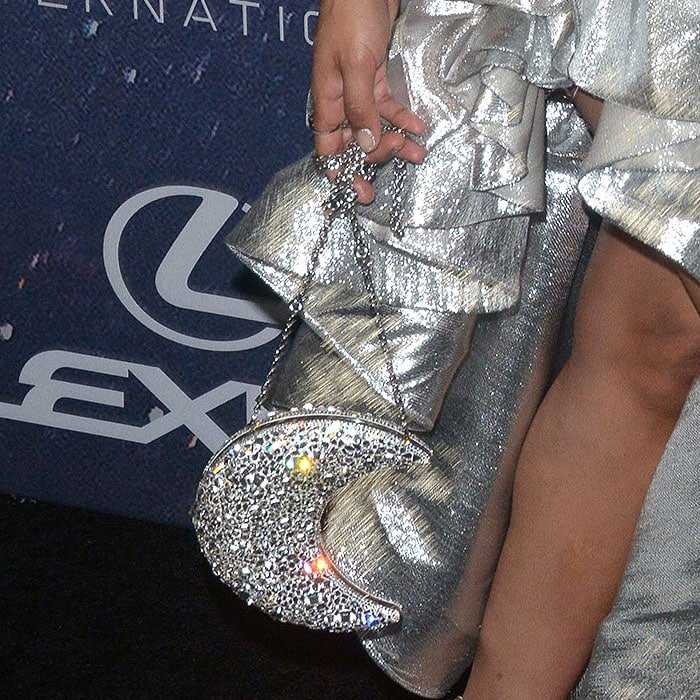 The silver crescent moon bag carried by Tessa Thompson