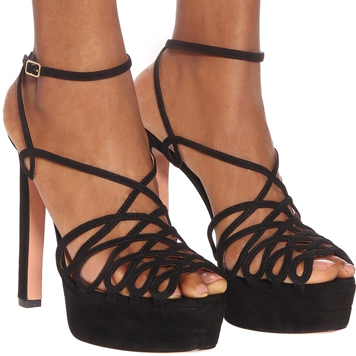 This pair has been crafted in Italy from smooth suede, boasting elegantly slender ankle straps and crisscross toe straps