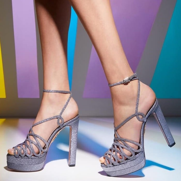 Made in Italy from luxe stardust fabric in chic antracite, this nod to 70's style features straps that criss cross across the foot, an adjustable ankle strap and is balanced on a sturdy platform sole