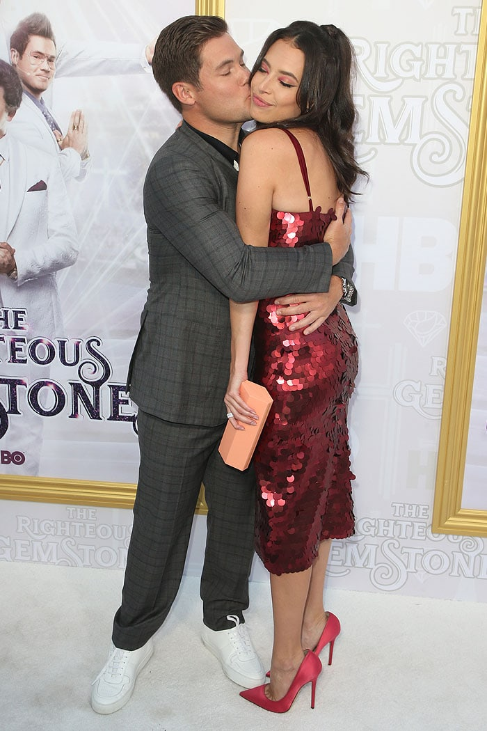 Chloe Bridges getting a hug and a kiss from Adam Devine