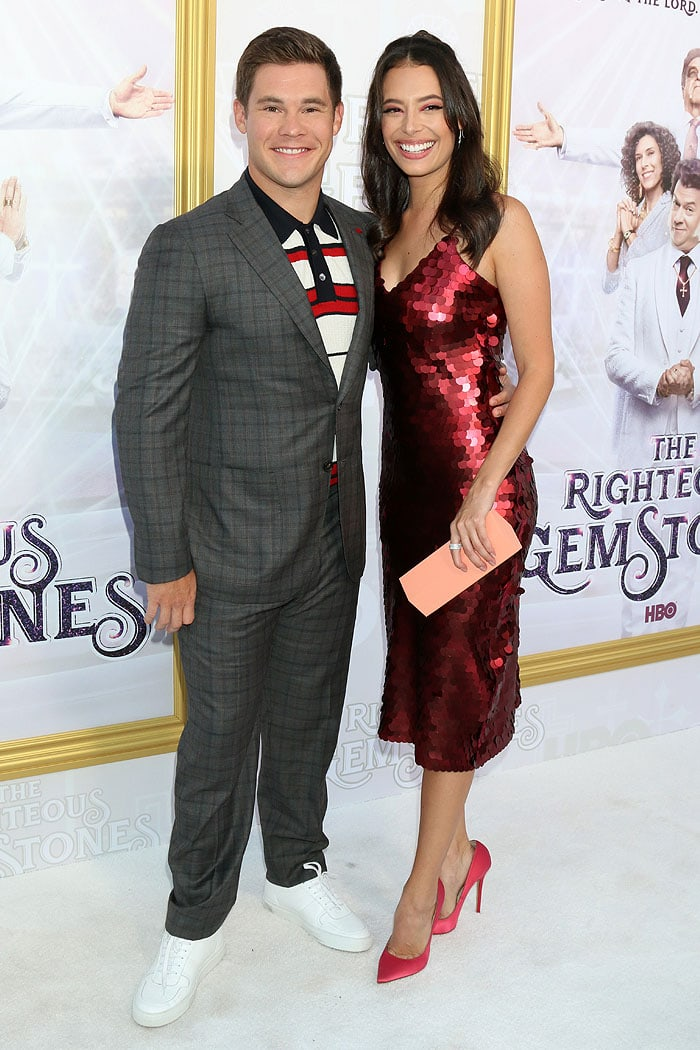 Adam DeVine and Chloe Bridges posing together at HBO's The Righteous Gemstones premiere