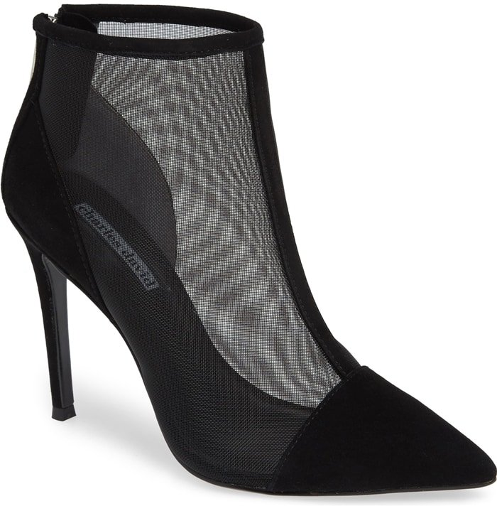 Semi-sheer mesh construction elevates the sultry style of a chic pointy-toe bootie lofted by a svelte stiletto heel