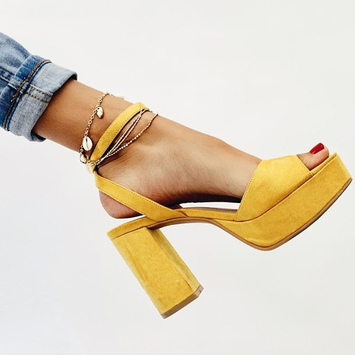 A tall block heel and a chunky rocker platform provide a delightfully retro foundation for a d'Orsay-profile Theresa san