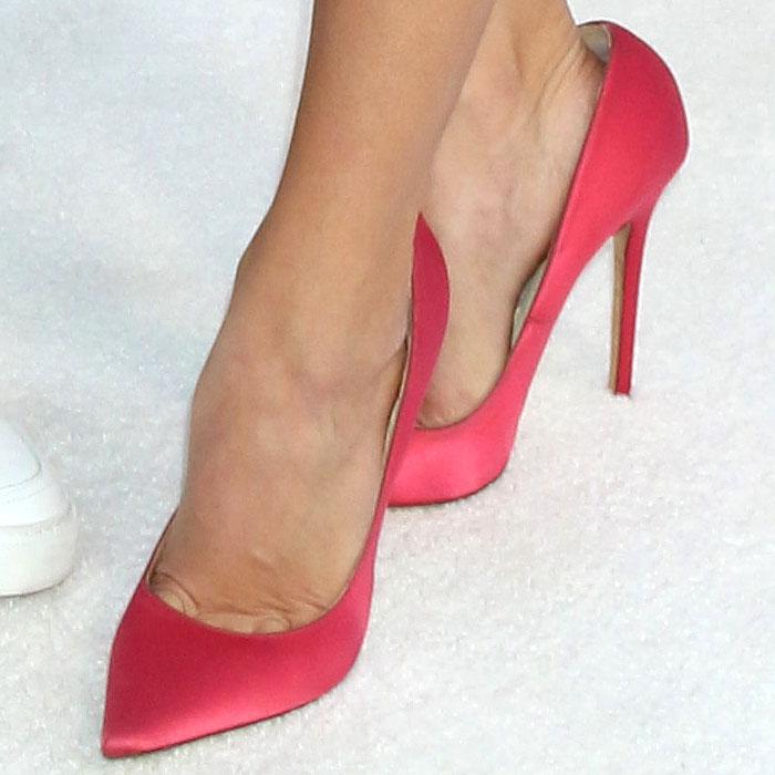 Closeup of Chloe Bridges' feet in too big pumps