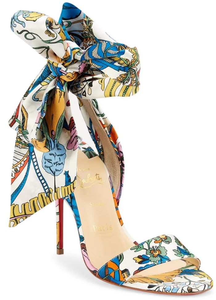 Bold printed pumps flaunt an oversized bow tie accent crafted of rich silk