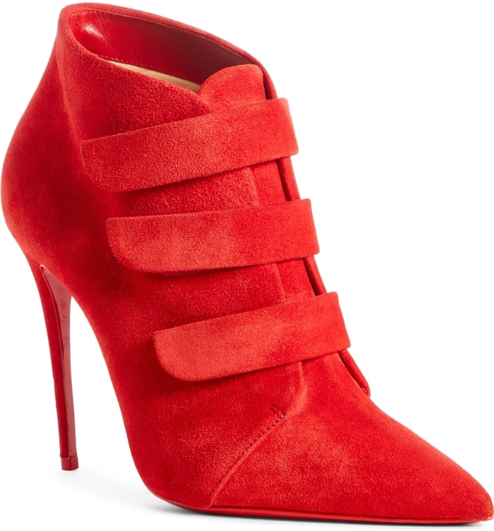 Get to the style point quickly in this stiletto bootie with easy, adjustable hook-and-loop straps bridging the vamp to perfect the fit and a signature red sole