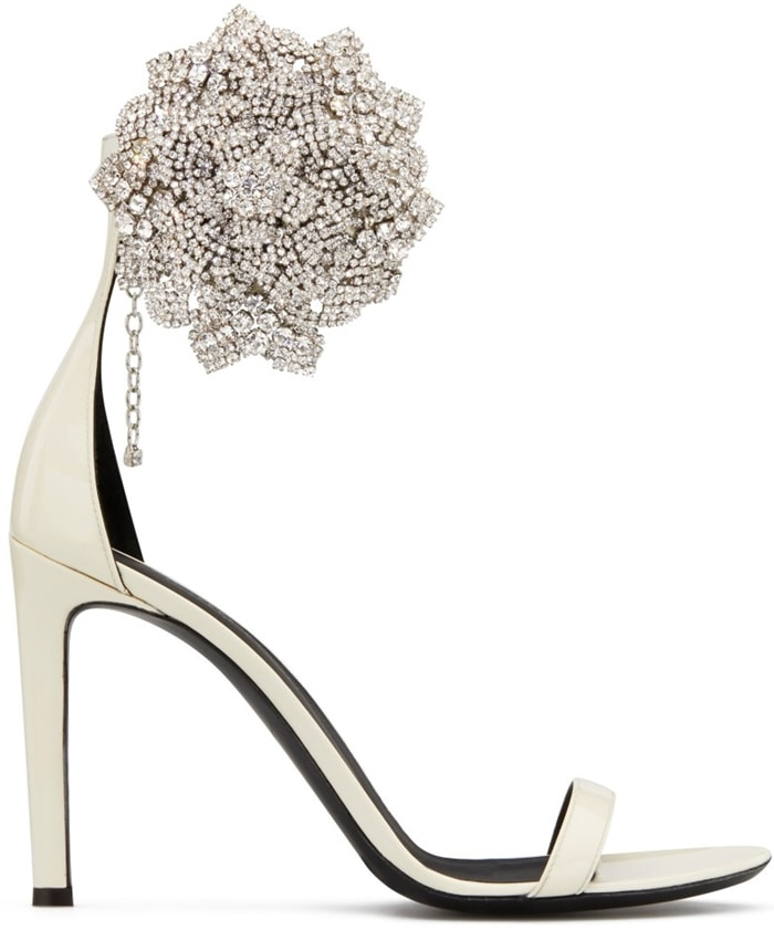 These high-heel, white patent leather sandals are characterized by the crystal flower accessory on the side
