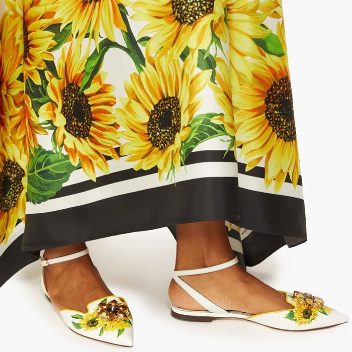 Dolce & Gabbana's fascination with vibrant blooms is expressed by these delightful white leather flats