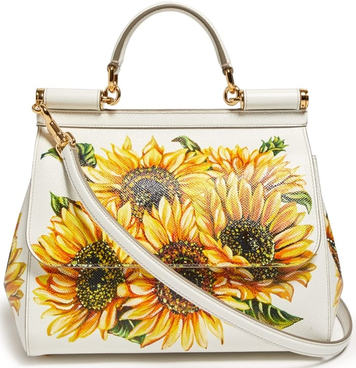 Dolce & Gabbana reimagines its coveted Sicily handbag with a sun-strewn aesthetic with the use of vibrant sunflowers painted across the front