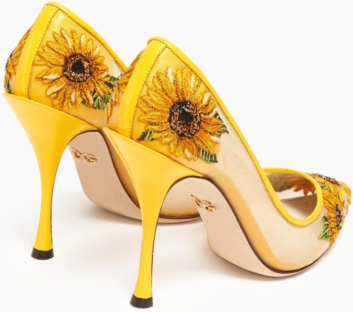 Dolce & Gabbana's bright yellow mesh pumps will bring a joyful note to your ensemble