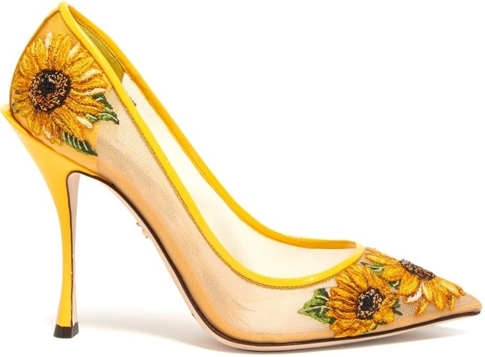 Embroidered with intricate sunflowers, they're shaped with a sharp point toe and sit on a leg-lengthening leather-covered stiletto heel