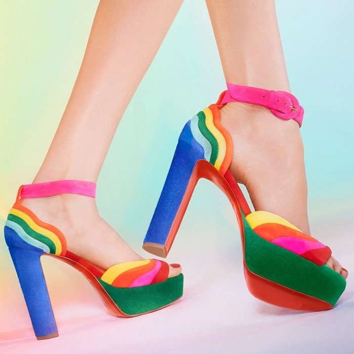 Layers of pure color curve around the counter and arc across the vamp of an ankle strap sandal sent skyward with a wrapped platform and major heel