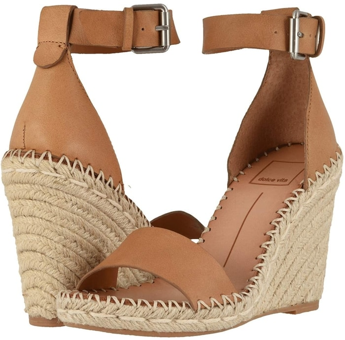 An espadrille-style wedge lends eye-catching summery height to a stylish sandal fashioned with a cuff of slim, stretchy straps