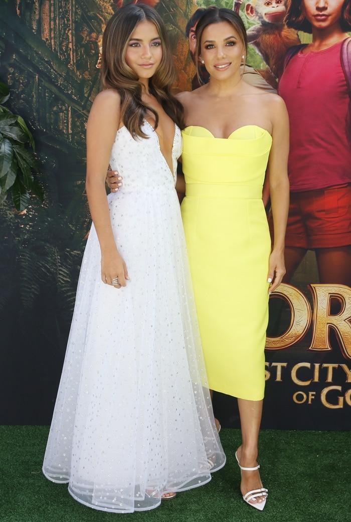 Isabela Moner's sexy cutout dress by Rodarte and Eva Longoria's yellow Vitor Zerbinato cocktail dress