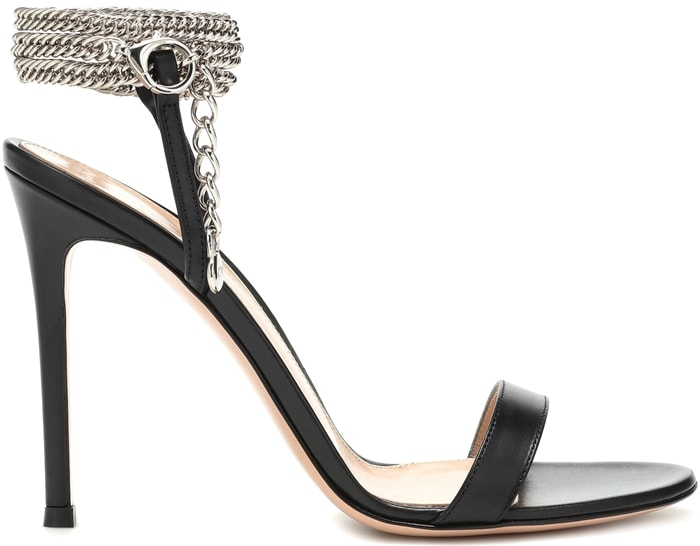 Crafted in Italy from black leather, the Debbie sandal features metallic chains around the ankle