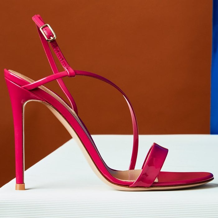 Expertly crafted in Italy from glossy and vibrant fucsia patent leather, the Manhattan sandal is Gianvito Rossi's take on the Nineties-inspired trend