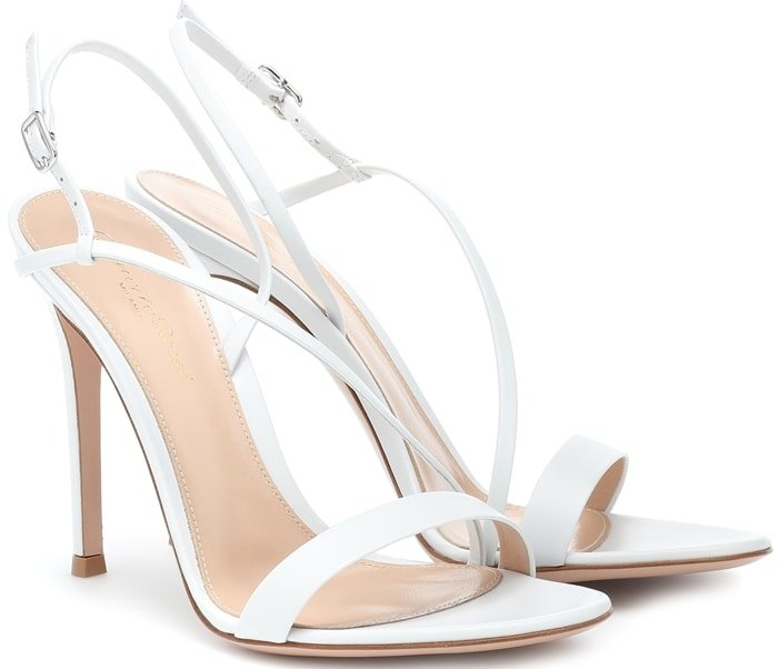 A pair of simple white strappy leather sandals is the perfect way to elevate your wardrobe as Gianvito Rossi offers one that is quietly elegant