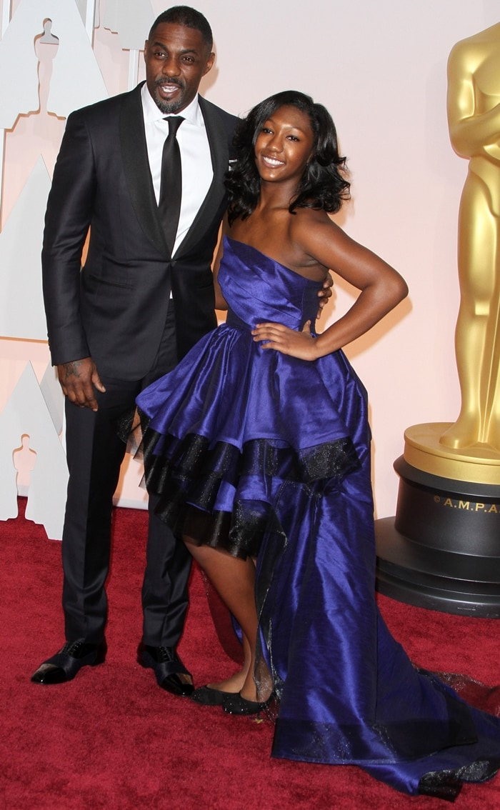 Idris Elba in an Ermenegildo Zegna suit with his daughter Isan Elba at the 87th Annual Academy Awards
