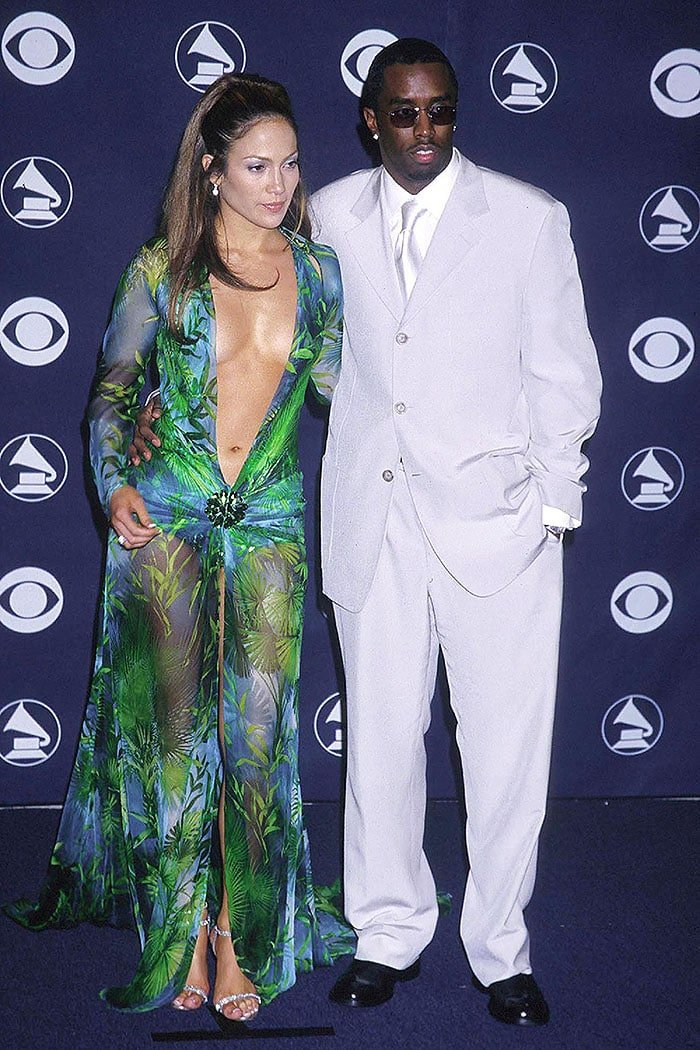 "Jennifer Lopez wearing the iconic green Versace dress as she posed next to then-boyfriend Sean ""Diddy"" Combs at the 2000 Grammy Awards"