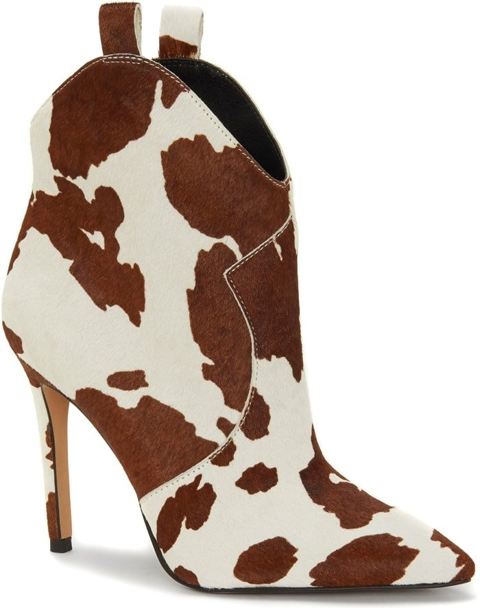 A stiletto heel provides a modern update for a Western bootie, while cow print spots pay homage to the style's rustic roots