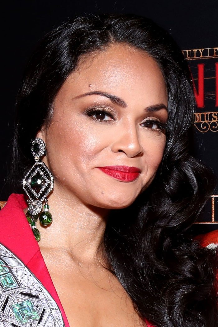 Custom emerald-hued Larry Vrba earrings on Karen Olivo