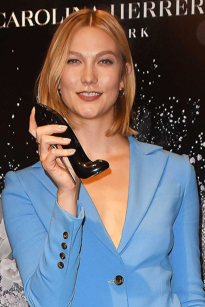 Karlie Kloss shows off the 'Good Girl' perfume's curvy, shoe-shaped, and gold-stiletto-ed bottle