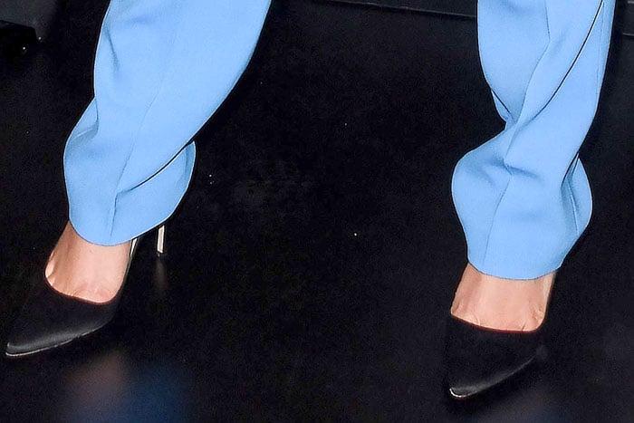 Karlie Kloss' feet in Gianvito Rossi black-satin pumps