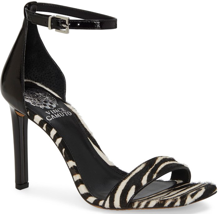 A lofty stiletto heel brings leg-lengthening lift to a barely there Lauralie sandal topped with a dainty ankle strap