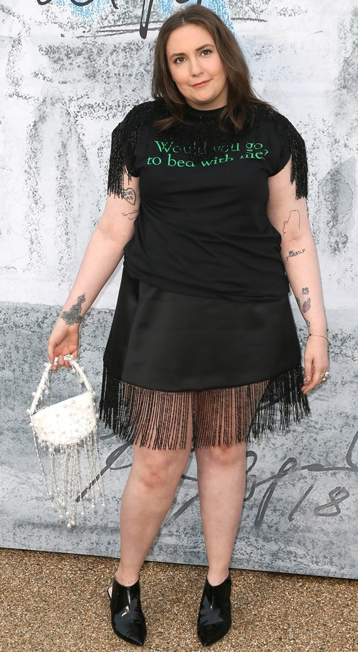 Lena Dunham's slogan print fringe-trimmed T-shirt at the Serpentine Gallery's Summer Party