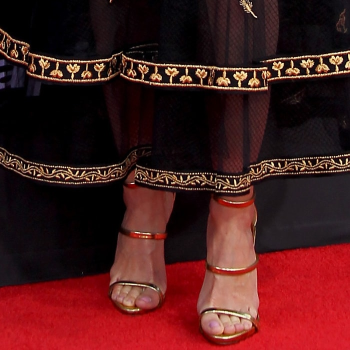 Linda Cardellini's hot feet in gold Harmony sandals by Giuseppe Zanotti