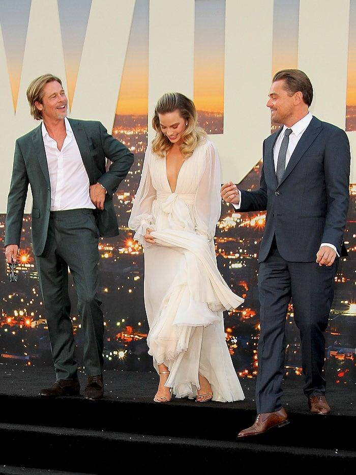 Margot Robbie with co-stars Brad Pitt and Leonardo DiCaprio