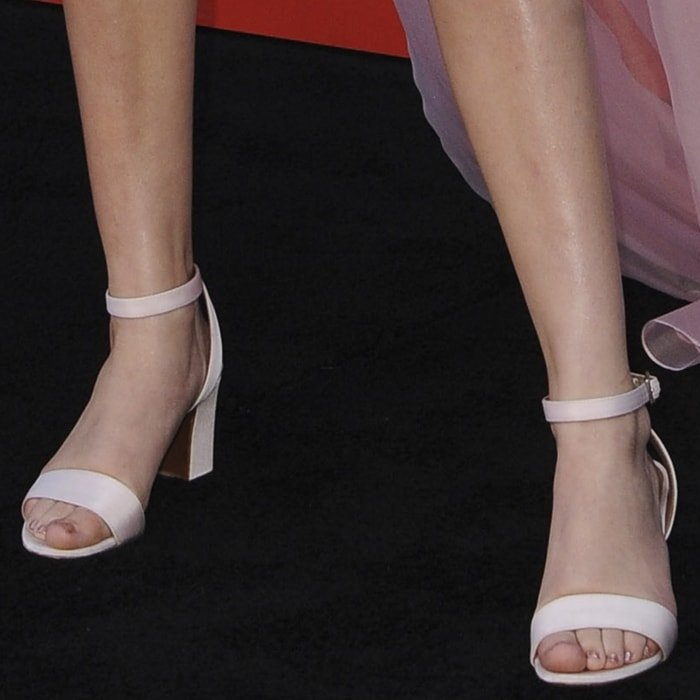 Millie Bobby Brown's pretty feet in Leticia satin sandals from Tabitha Simmons