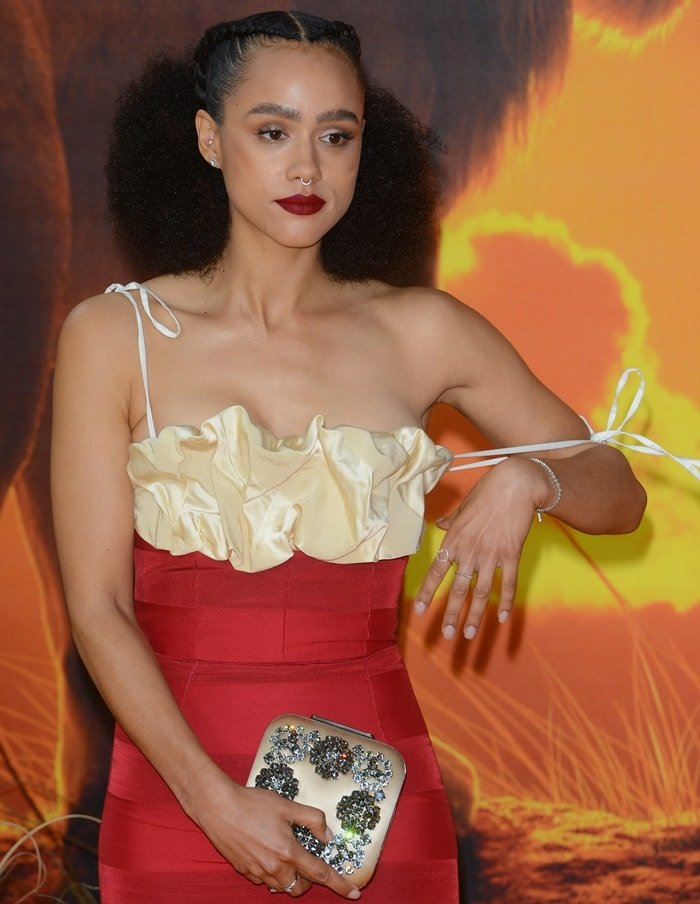 Nathalie Emmanuel's Rosie dress made from satin detailed with panels of tactile ribbing