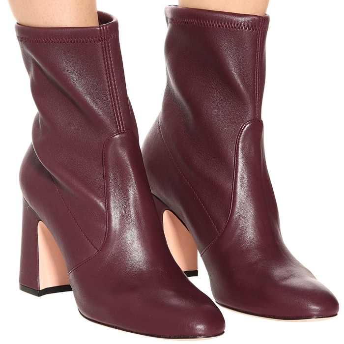 Stuart Weitzman's Niki ankle boots have been crafted in Spain from smooth leather in a warm burgundy hue