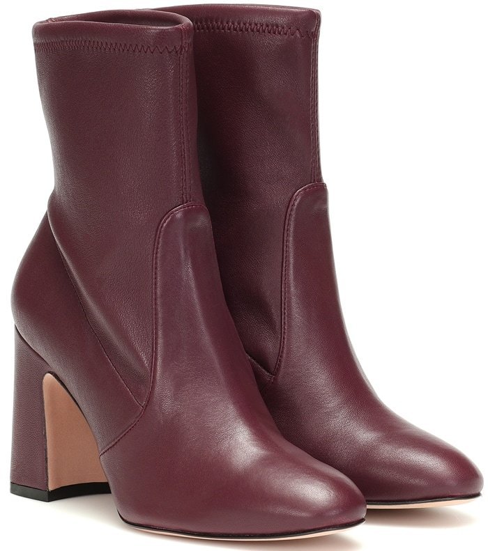 These boots are set on a 90mm block heel for lofty elevation and a have a paneled high neck