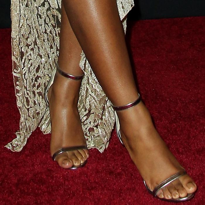 Normani Kordei's hot feet in metallic stiletto sandals