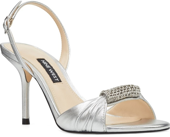 Crystal-trimmed barrel hardware cinches the vamp of an elegant sandal detailed with a slingback strap and slender, wrapped heel