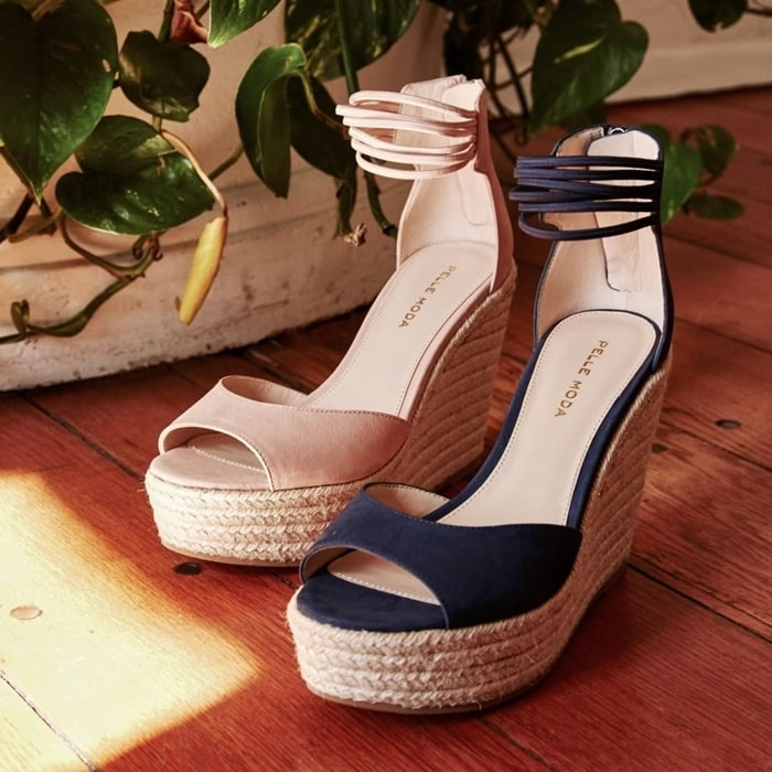 Take your trendsetting look to new heights in Raven espadrille platform wedge sandals