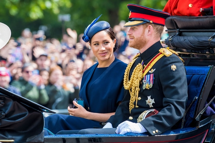 Meghan Markle rides in a carriage with her husband Prince Harry during the Trooping the Colour festivities
