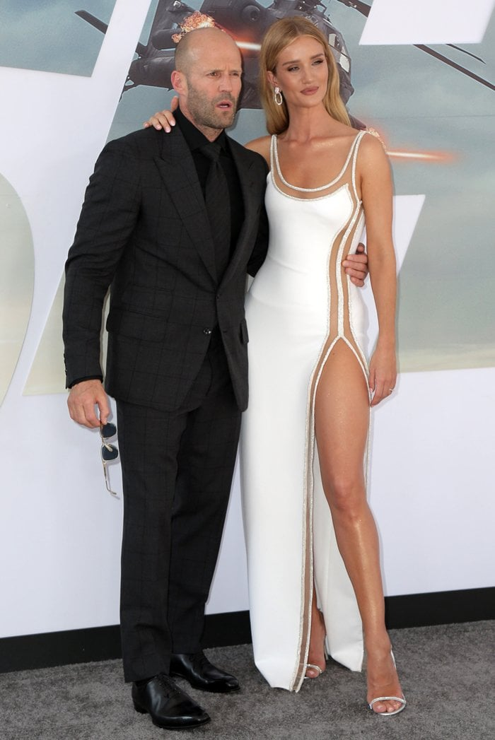Jason Statham and Rosie Huntington-Whiteley pose together on the red carpet at the premiere of Hobbs & Shaw