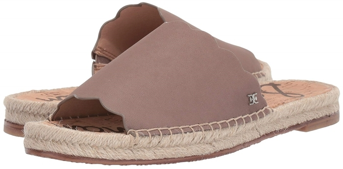 Scalloped edges provide a fresh twist for this suave espadrille-style slide sandal