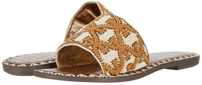 Set off on an urban safari in this flat slide sandal with a stunning animal-pattern beaded strap and whipstitching at the sole