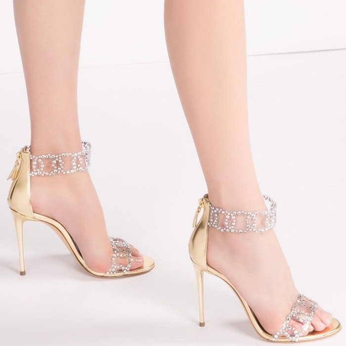 Expertly crafted in Italy from gold-toned leather, these Sirene sandals from Casadei are embellished with crystal applications, meant to resemble tiny water drops on the foot's skin
